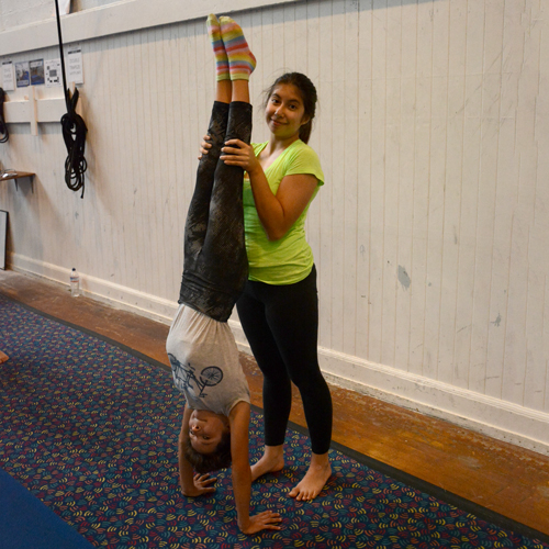 Students for the Pre=professional Youth Program practicing their handstands | Circus Center | San Francisco