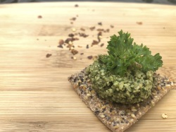 Carrot top pesto on cracker