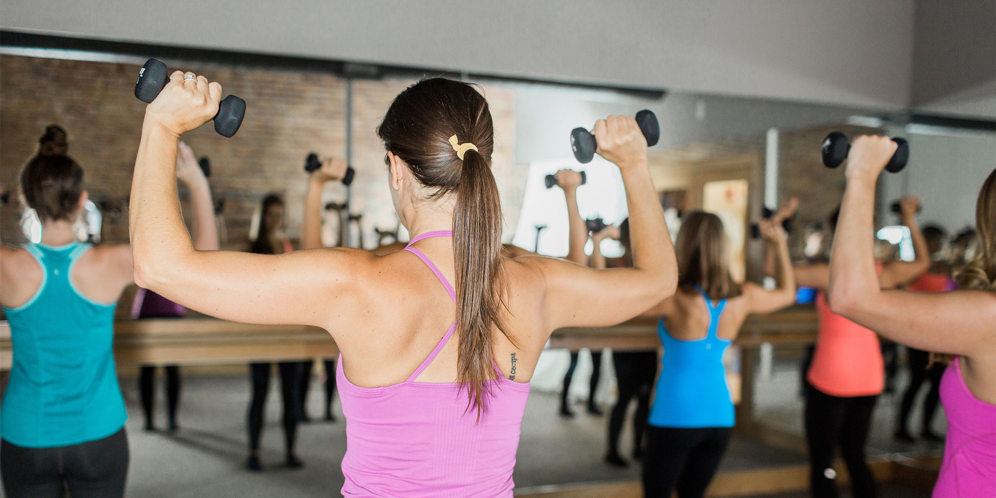 Women lifting weights at Simply Barre